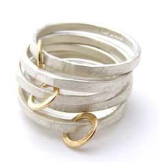 Beautiful hand made Silver and 9ct gold hoop rings by the fabulous British designer Jane Kenny.The image shows the silver with