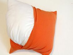 How To Make Throw Pillows Out of Old T-Shirts: Stuff the pillow through the back envelope opening.  From DIYnetwork.com