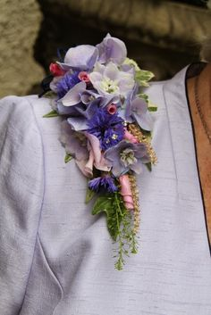 The Bride's Mum's Epaulette Corsage of Rolled Rose Petals, Delphinium and Cornflowers with Astilbe and Hydrangea Florets