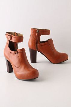 A tall, wide ankle strap sets the bar high for Schuler & Sons' hidden-platform boot