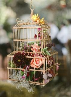 #birdcage full of #flowers. great design theme. #wedding #party #hanging #decor