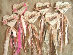 How fun, Valentine's wands. Wrap ribbon around dowel, add paper or wooden hearts, decorate & tie ribbon at base.
