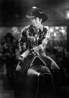 American actor John Travolta rides a bucking bronco machine in a scene from the film 'Urban Cowboy' 1980 Jon Travolta, Urban Cowboy Movie, Debra Winger, Young John, Hot Cowboys, Hat Day, Actor John, Paramount Pictures, Brad Pitt