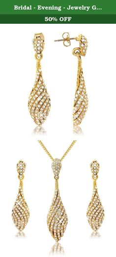 Bridal - Evening - Jewelry Gift Set - Gold Tone- Swirl Necklace Pendant With Earrings Set - Gift Boxed - For Her. A magnificent yellow gold tone intricately designed spiral theme necklace set with matching earrings. Inspired by an elegant spiral design in a pear drop shape it is very light to wear. The necklace frame is a gold colour complemented throughout by stunning white Austrian crystals. Measurements: Chain 40cm (full length) Pendant 5cm length x 1.5cm (widest width) gradually...