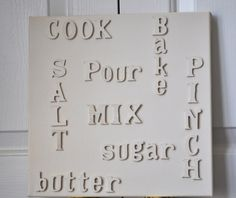 Cute DIY kitchen decor.     Buy a canvas and wooden lettering    spray paint lettering desired color    and hot glue to canvas    Tadaa! Hang up :-)