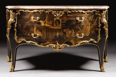 c1750 A gilt-bronze-mounted black and gilt Chinese lacquer commode stamped Macret twice Louis XV, circa 1750  200,000 — 300,000 GBP 313,940 - 470,910USD. Unsold