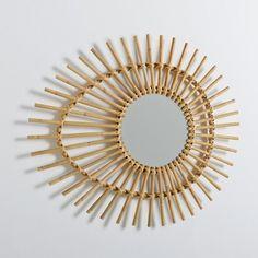 """Le miroir forme oeil vintage Nogu. Aérien et tendance vintage, le miroir Nogu semble tout droit sorti d'un intérieur des années 50 et 60.Description du miroir """"oeil"""" vintage Nogu :Fixation murale, piton non fourniCaractéristiques du miroir """"oeil"""" vintage Nogu :Rotin et canne de rotin naturelFinition coloris naturelDécouvrez la collection Nogu sur laredoute.frDimensions du miroir """"oeil"""" vintage Nogu :Miroir :Diamètre 23 cmTotales :Longueur: 73 cmHauteur: 30 cm"""