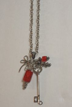 """#Handmade Y #necklace, 34"""" long, silver tone chain and skeleton key metal work, #dragonfly charm, 1"""" rectangle, dark #orange lampwork beads. Necklace may be lengthened or short... #trending #jewelry #necklaces #antique #vintage #handmade #bracelet #earrings #coordinating"""