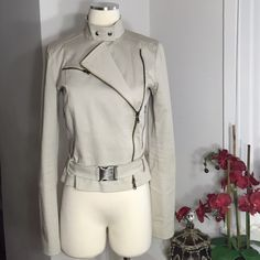 Patrizia Pepe Moto Jacket Pair it with your favorite jeans and you're set! In a grey color with front zipper closure, front side zippers, hip belt, lined. Made in Italy. Sized IT 44 which is a US Medium but runs small, firs a size Small best. Measurements upon request. Fabric: cotton, elastane. Mint condition. All reasonable offers are welcome! Please make all offers through the offer button Patrizia Pepe Jackets & Coats Utility Jackets