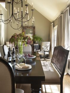 Beautiful Dining Room!!  Love the table, curtains and the plants add a nice color of green to the room. I also like the arrangement of chairs and buffet table at the end of the room.