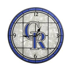 MLB Colorado Rockies 12-Inch Art Glass Clock by The Memory Company. $22.58. Add a touch of classy team loyalty with this stunning new wall clock! It's a timely addition to a den, dorm or wherever you choose to display team loyalty with style. A generous 30-inch diameter, there's plenty of room for the team mascot or logo, beautifully portrayed in full color.. Save 10%!