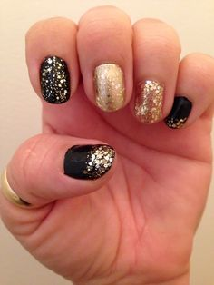 Essie nail polish in Licorice, Good as Gold and Nicole by OPI Kissed at Midnight.
