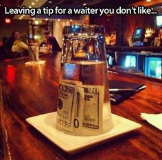 Leaving a tip for the waiter you don't like.