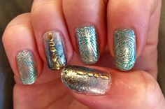 Silver sparkle OPI nail polish with Whim blue gold glitter fade, bundle monster  nail stamping and metal appliques. Love it! This would make a great mermaid theme base nail #glitternails #nailart #nailstamping #mani