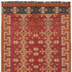 NILA KILIM RUG - A handwoven kilim with a strikingly modern color combo that contrasts pale blue with shades of orange, ochre, ivory and brown.