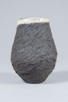 Daisy Cooper Ceramics  Vulcan Vase: This vase is hand crafted using coarse black vulcan clay with a beautiful raw textured exterior and matt white crackled glaze on the inside.