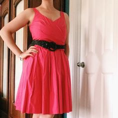 """Ralph Lauren coral dress Alluring yet sophisticated. Rich coral color. Faux wrap, sleeveless style with fabric belt (and pockets!) Side zip. Fully lined. Weighted cotton material, so it holds its shape. Potentially tea length depending on your height; I am 5'8"""" (model) and it falls at my knees. A little sexier than a v-neck with the scalloped bust. Only worn once. Questions, bundles and offers welcome. Ralph Lauren Dresses Midi"""