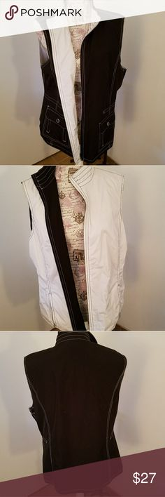 Reversible Black and White Vest Reversible Black and White Vest. Size XL. In Great Condition. Has different types of pockets on each color side. Versatile! SPANNER Jackets & Coats Vests