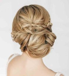 Something like this with the braids and gathering but gathered to the side into a side half-updo
