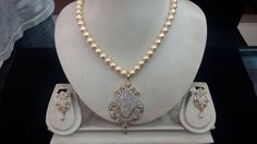 Shell Pearls with American Diamond Pendant