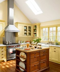 Yellow Kitchen Makeover with antique island, beadboard backsplash, marble counter, white apron sink
