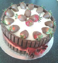 Fresh cream, dipped strawberries and kit Kat
