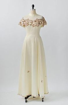 Vintage cream colored wedding gown with illusion neckline and very pretty copper and rose quartz colored sequins along top, scattered on skirt and trimmed along the hemline. 1960s Wedding Dresses, 1960s Outfits, Vintage Dresses 1960s, Vintage Clothing, Party Dresses, 1960s Fashion, Vintage Fashion, Vintage Style, Vintage Glamour