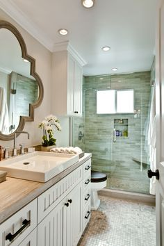 This charming bathroom in a Malibu Home I remodeled, really shows how you can make a small bathroom look incredible!  I particularly like the mirror that I had hand faux finished to match the stone that was used in various shapes and sizes throughout this bathroom.