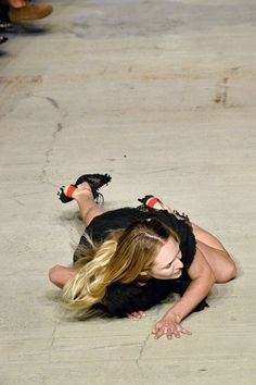 Candice Swanepoel falls down on the Givenchy catwalk
