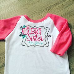 A personal favorite from my Etsy shop https://www.etsy.com/listing/253257402/personalized-big-sister-raglan-tee