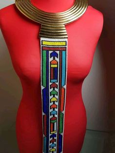 No one can resist this stunning Ndebelet beaded necklace. Available in two colours. Beaded Necklace Patterns, Beaded Tassel Necklace, African Necklace, African Jewelry, African Print Fashion, Fashion Prints, Ethnic Fashion, African Hats, African Accessories