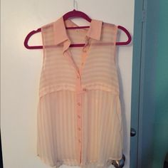 Sheer striped pastel coloured tank top Sheer tank top with cream and coral stripes with gold buttons. Great addition to spring and summer attire. Only worn a couple of times. Looks really good with jeans and white pants. Tops Button Down Shirts