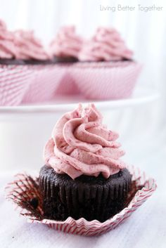 These dark chocolate cupcakes are topped with a whipped raspberry vanilla creme frosting that's out of this world!