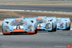 This outstanding photo of three iconic Gulf Porsche 917s at Rennsport Reunion was voted Best Vintage Car Racing Photo of 2015 by the readers at Sports Car Digest. (Photographer: Dennis Gray)