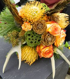 Another Montana inspired Bridal bouquet using antlers, feathers, pincushion protea and pods.