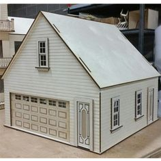 Made in the USA from Baltic birch plywood garage/workshop kit in scale. Includes 16 x 7 inch working garage door, working windows and door. Cabin Dollhouse, Dollhouse Kits, Dollhouse Miniatures, Entry Doors, Garage Doors, Front Entry, Car Garage, Advent House, Baltic Birch Plywood