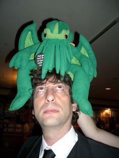 Neil Gaiman wearing Cthulhu for a hat.