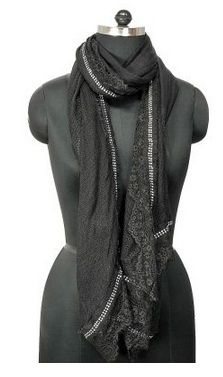 Add a dash of glamour to your overall look by wrapping this black and white scarf by Tiekart. Made from a Viscose, it is also extremely soft against the skin.