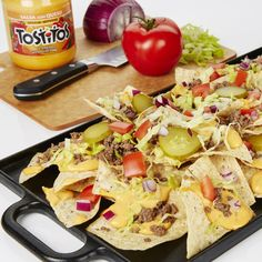 Cheeseburger Nachos - Create the tastiest Cheeseburger Nachos, Tostitos® own Nachos recipe with step-by-step instructions.