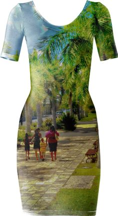 Stroll Among The Palm Trees Bodycon Dress is great to wear to work, play or evening.Our Stroll Among The Palm Trees Bodycon Dress is wonderful to wear for your event. It has beautiful tall green palm trees while a family walks between them on a beautiful Sunday afternoon. This scene was photographed in exotic St. Croix US Virgin Islands in Frederiksted near the beautiful Eliza James McBean Clock Tower where many events, including weddings are held. Photo Denise Bennerson, Photographer