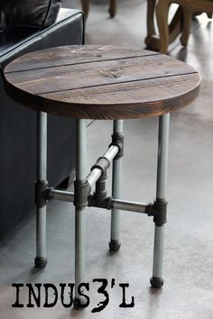 Disponible chez Sueño Mobilier & Accessoires. Available at Sueño Furniture & Accessories. https://www.facebook.com/suenomobilieretaccessoires http://suenomobilieretaccessoires.com/ #industrial #industriel #wood #reclaimed #recycled #pipes #metal #furniture #sidetable #table #small #round