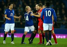 Liverpool's Steven Gerrard laughs off Everton's Steven Naismith in a bust up during their Merseyside clash.  Steven Gerrard wore the adidas Predator Instinct FG Football Boots in Red and Purple.  These boots are available to buy here for £64.95 with Galaxy Sports online. 100% Authentic. Worldwide Shipping.   Photo Credit: Richard Heathcote/GettyImages