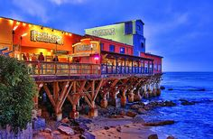 The colorful Fish Hopper on Monterey Bay    The colorful Fish Hopper Restaurant on Monterey Bay just after sunset. Located along the famous Cannery Row in Monterey, CA.