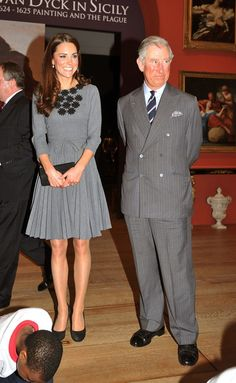 Catherine, Duchess of Cambridge and Prince Charles, Prince of Wales watch children produce artwork during a visit to the Dulwich Picture Gallery on March 15, 2012 in Dulwich, south London, England.  Catherine will repeat this Orla Kiely dress again in October 2015.