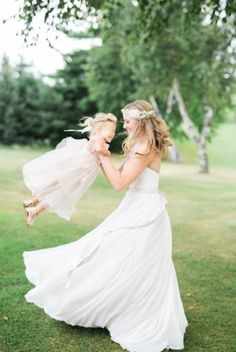 The sweetest bride and flower girl photo to recreate: http://www.stylemepretty.com/wisconsin-weddings/middleton-wisconsin/2015/09/14/rustic-romantic-garden-inspired-wisconsin-wedding/ | Photography: Booth Photographics - http://boothphotographics.com/