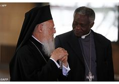Cardinal Peter Turkson speaks with the Patriarch of Constantinople Bartholomew I at the  Paris Summit of Conscience for the Climate, on July 21, 2015. - AFP