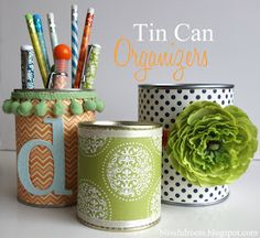 Blissful Roots:  DIY Tin Can Organizers.  Creative way to upcycle cans.  Fabric flower and dingle-balls with monogram are quite adorable.
