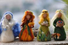 Needle Felted Waldorf  Wool Fairy-Winter-Waldorf inspired standing doll-soft sculpture -needle felt by Daria Lvovsky. $22.00, via Etsy.