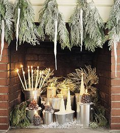 DISPLAY :: This fireplace has a cozy, woodsy feel to it. Silver stands (galvanized pails & small tubs, paint cans...) combined with candles, greenery & pinecones make for a perfect holiday display. CLICK for more easy Christmas displays from Better Homes & Gardens.