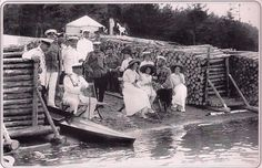 Grand Duchesses Tatiana, Anastasia, and Olga with their father on the river bank: 1912.